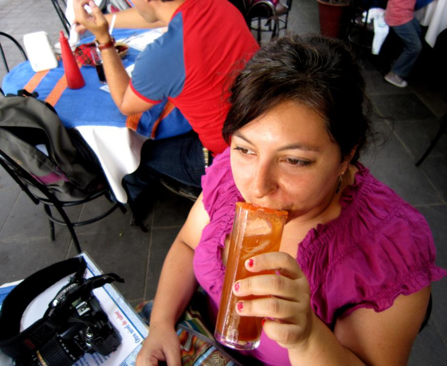 Beth sipping a Michelada.
