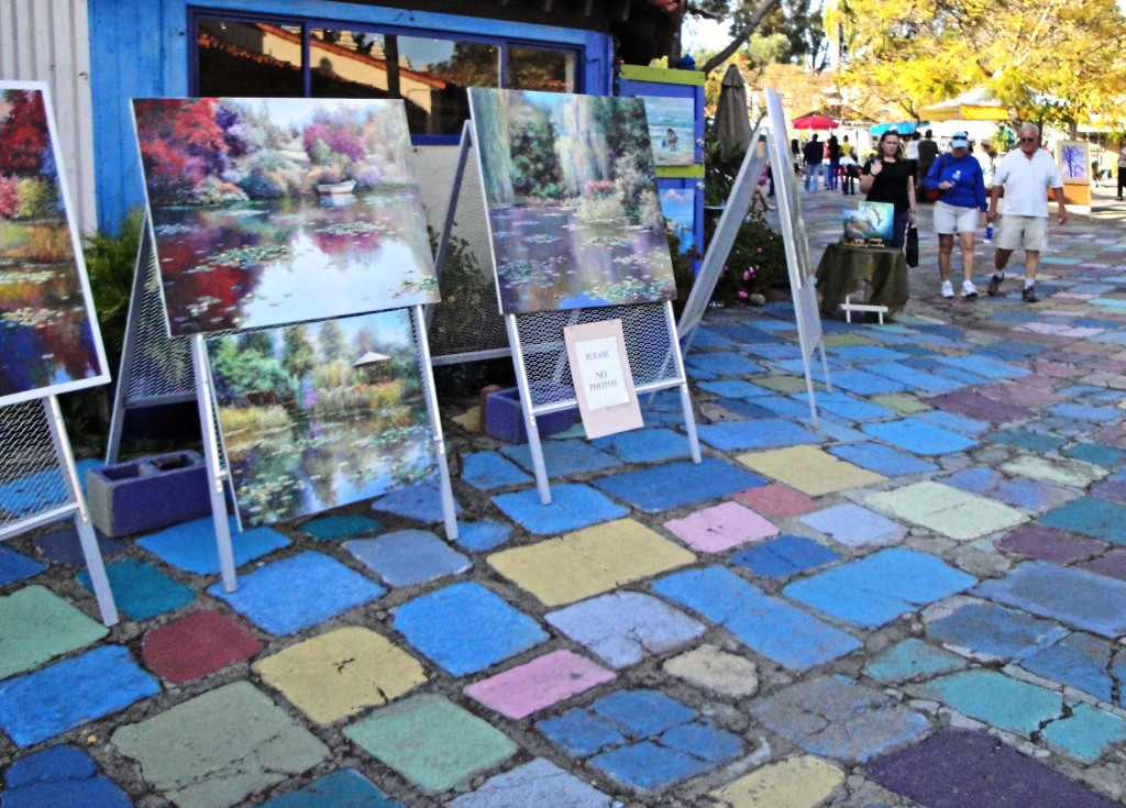 Paintings for sale at the Spanish Art Center.