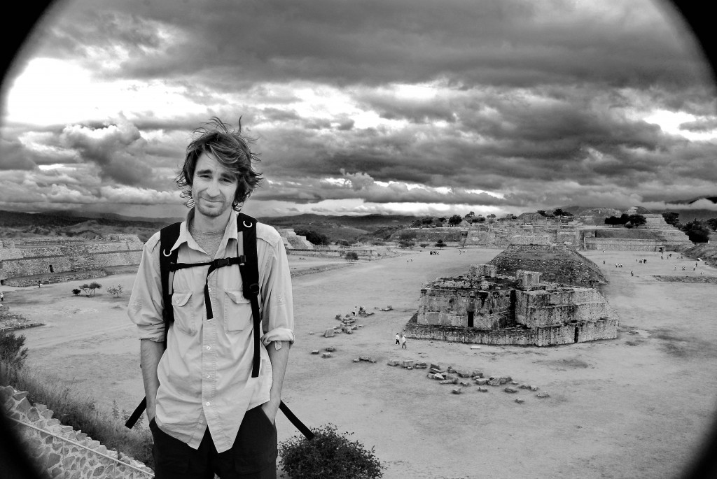 A photo of a traveler in his 30s on a high terrace in Mount Alban, Mexico.