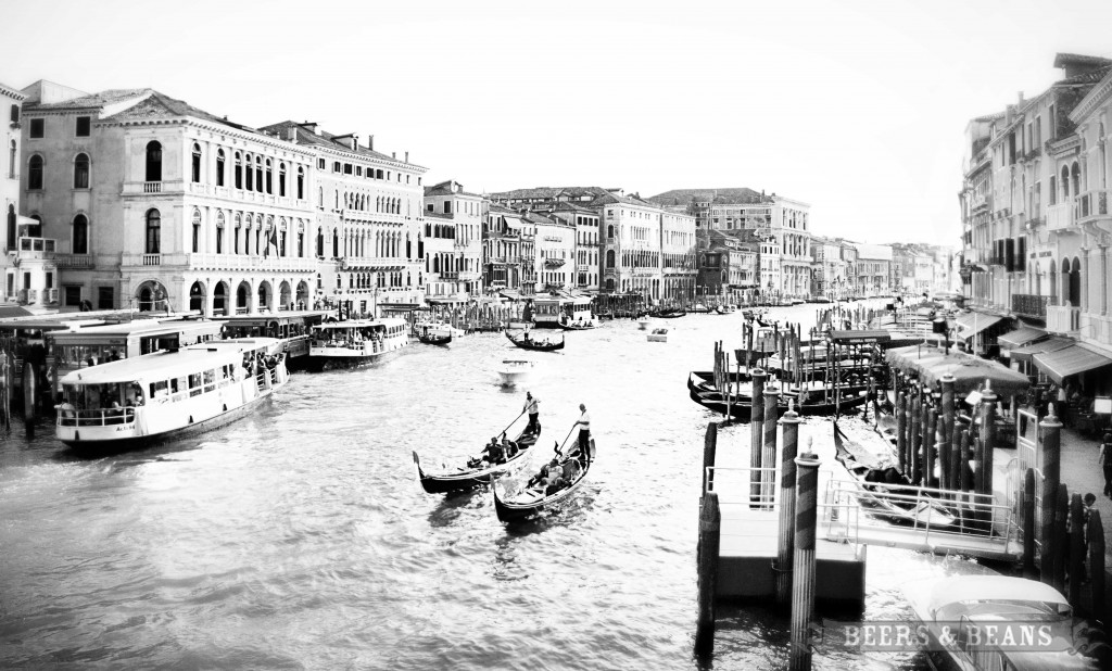 Looking out over the Grand Canal from the Rialto Bridge in Venice, Italy.