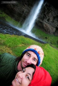 A young couple near Seljalandsfoss waterfall in Iceland