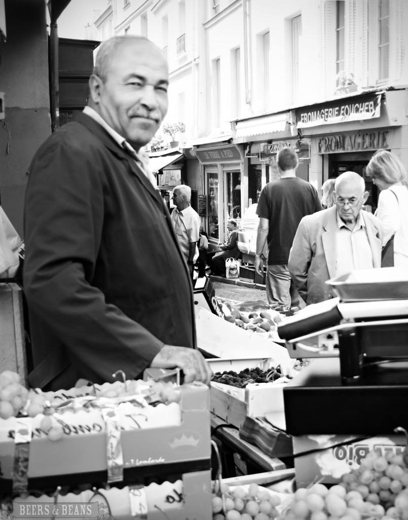 Fruit market vendor in Paris smallerforBnB 805x1024 Scenes From A Paris Market   A Travel Photo Essay