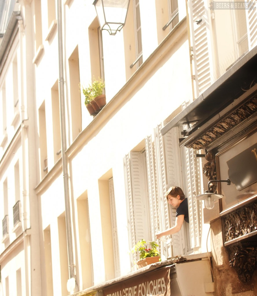 Girl watering her plants in Paris smallerforBnB 887x1024 Scenes From A Paris Market   A Travel Photo Essay