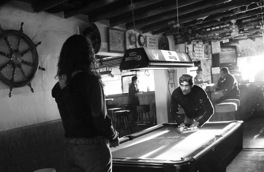 A couple playing pool in the La Salina Beach Club and Cantina.