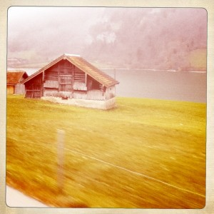 The view from outside of a train going through the Swiss Alps.