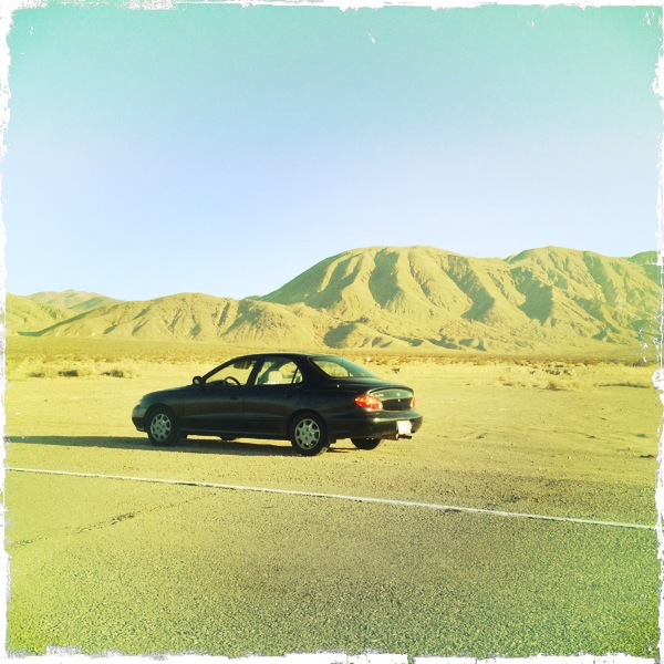 A hyundai parked in the southern California desert.
