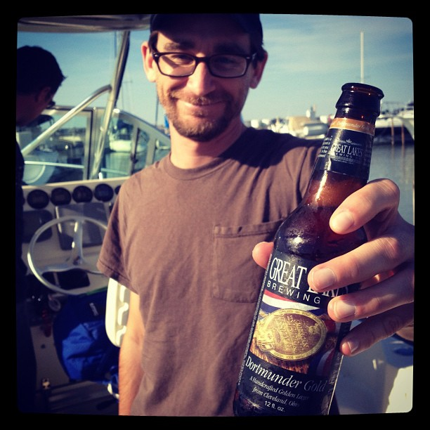 A beer drinking journalist on a boat on Lake Erie.