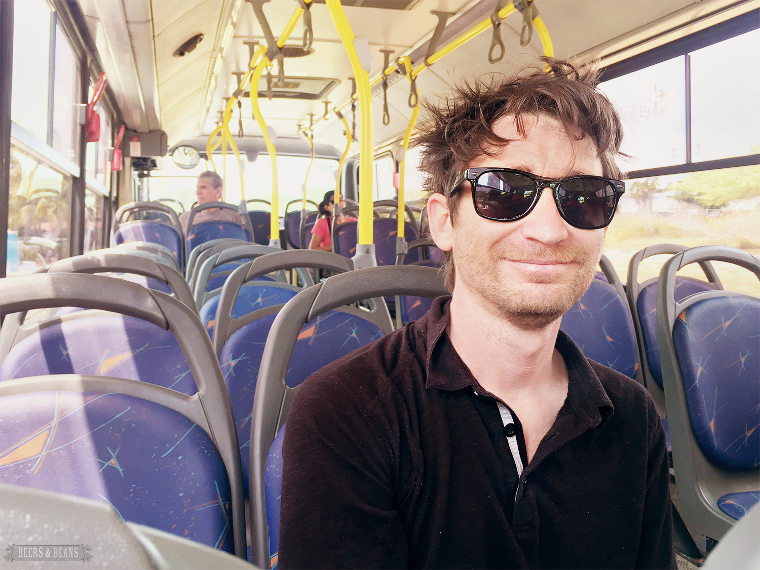 Randy Kalp, co-creator of the travel scarf, riding the public bus to the beach in Aruba.