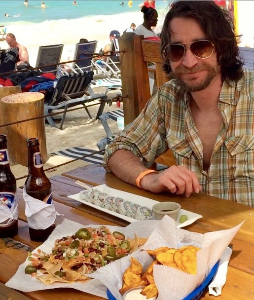 Randy Kalp eating at Beachers on West End Beach in Roatan, Honduras.