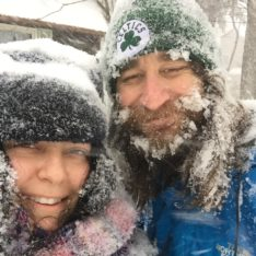 Speakeasy Travel Supply Founders Bethany Salvon and Randy Kalp smiling in a snow storm.