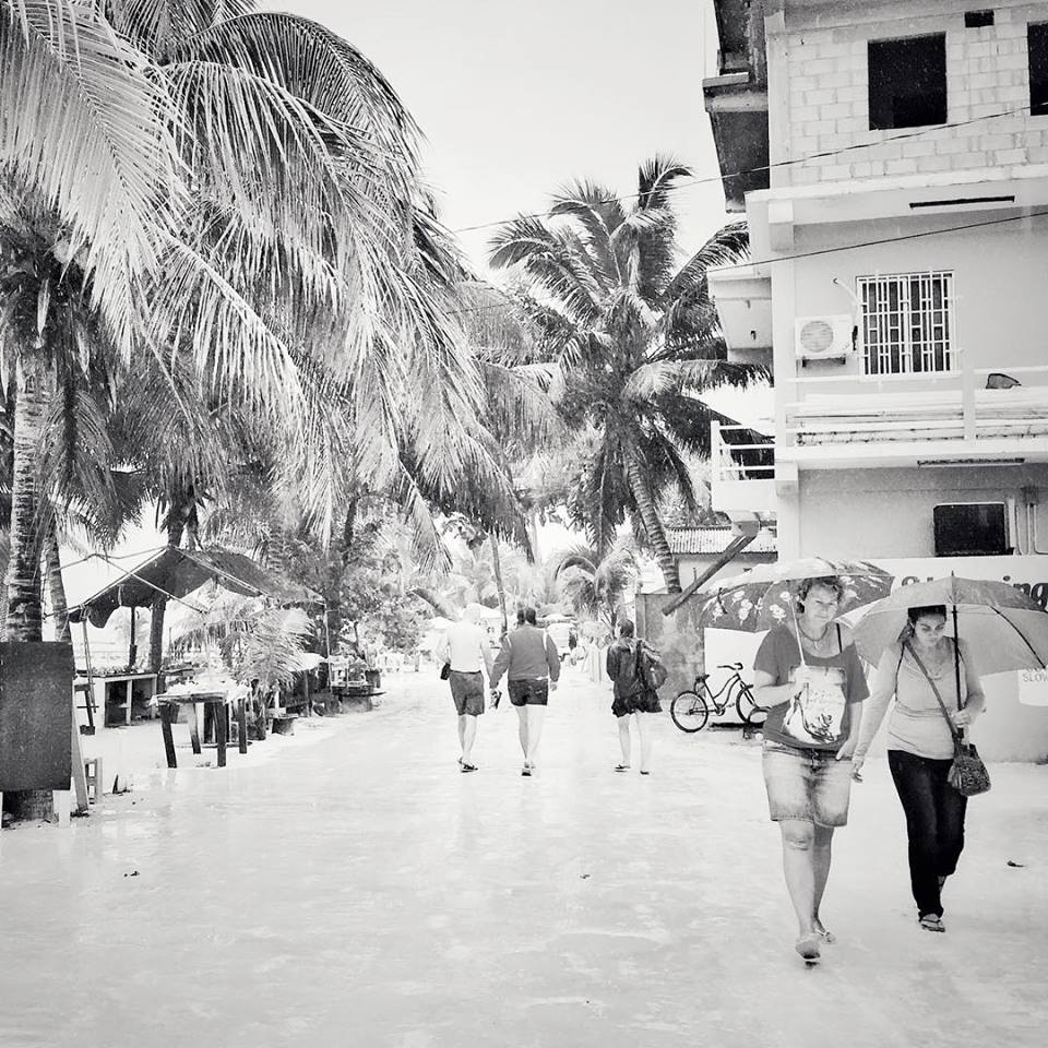 Tourists walking in Caye Caulker, Belize.