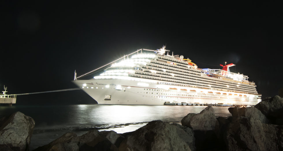 The Carnival Vista in the port of Curacao at night.