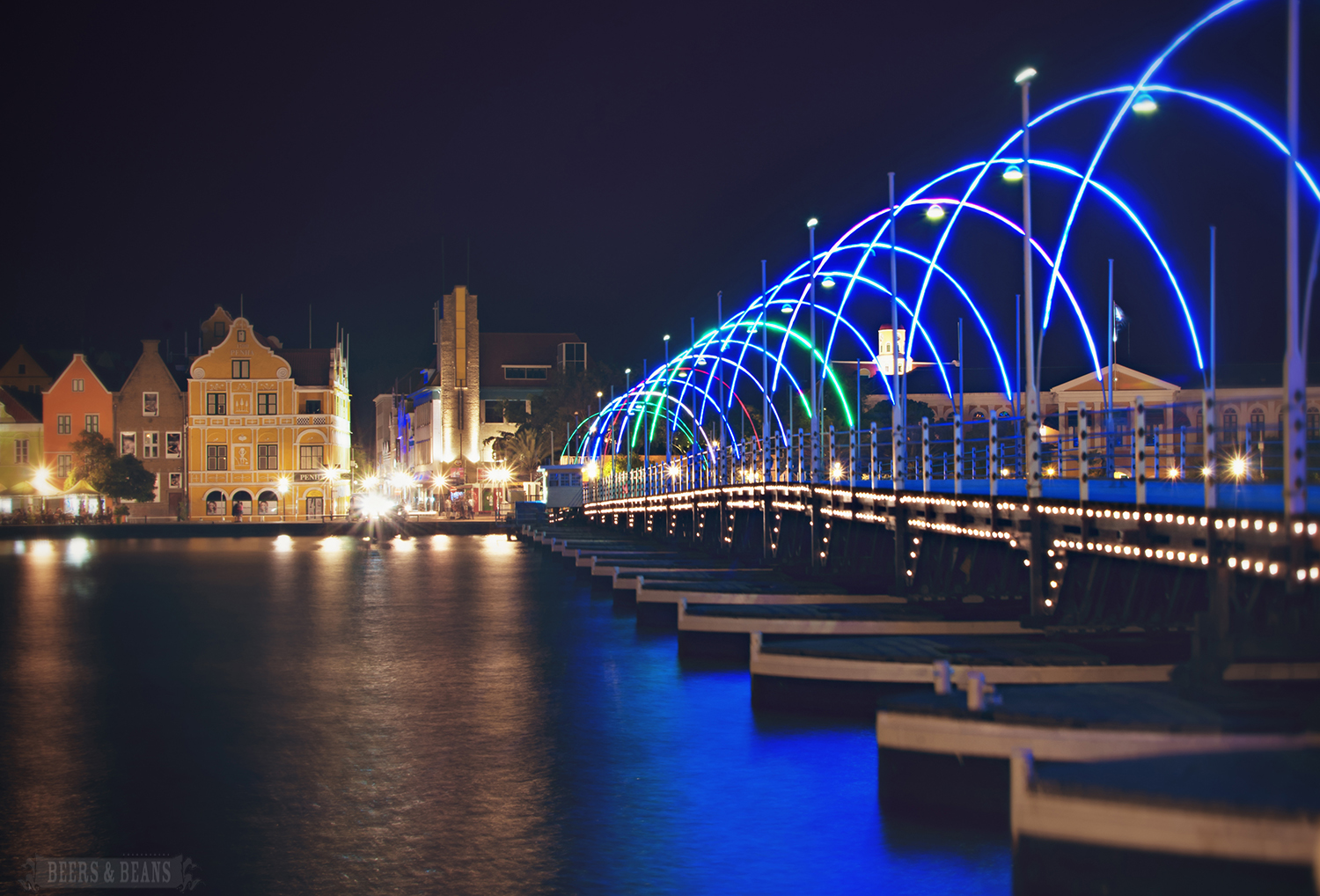 A bridge with colorful lights in Curacao.