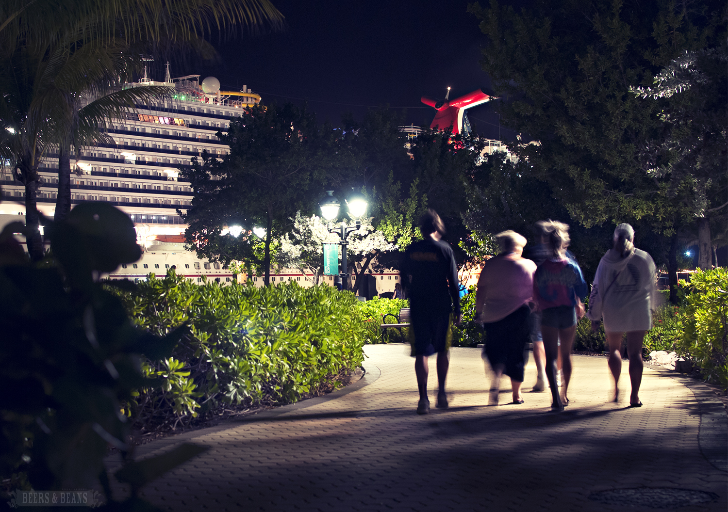 A family walking back to the Carnival Vista at night in the Dutch island Curacao.
