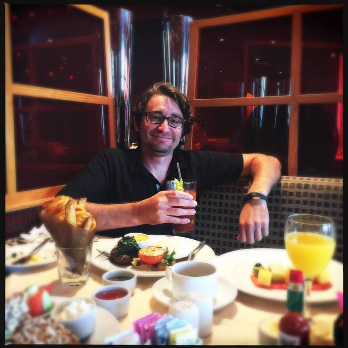 A man enjoying the Sea Day Brunch aboard a Carnival cruise ship.