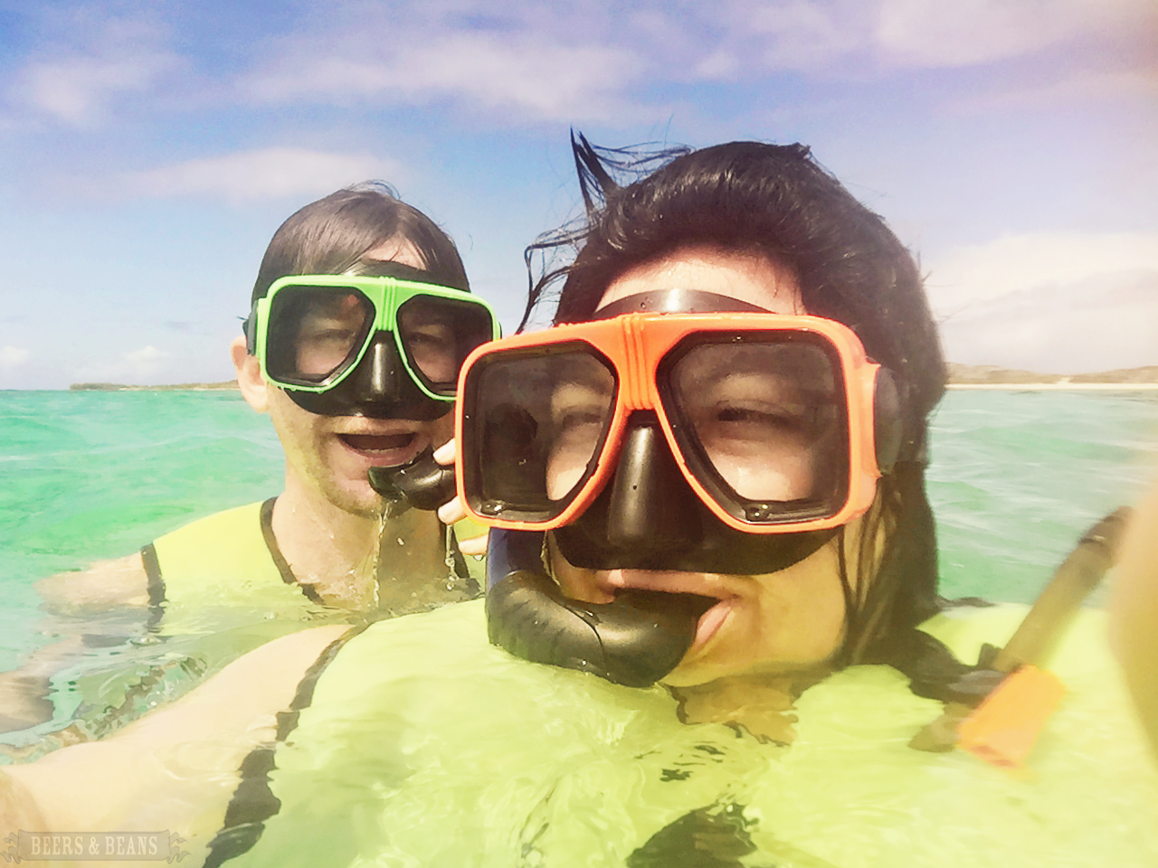 Speakeasy Travel Supply founders Bethany Salvon and Randy Kalp snorkeling in Grand Turk.