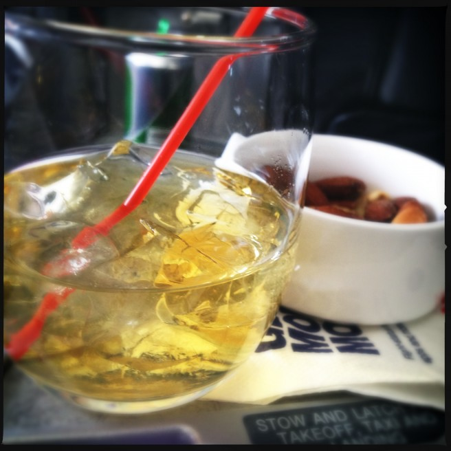 A scotch and warm peanuts from American Airlines first class.