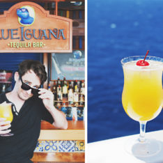 A traveler drinking cocktails at the Blue Iguana Bar on the Carnival Vista.