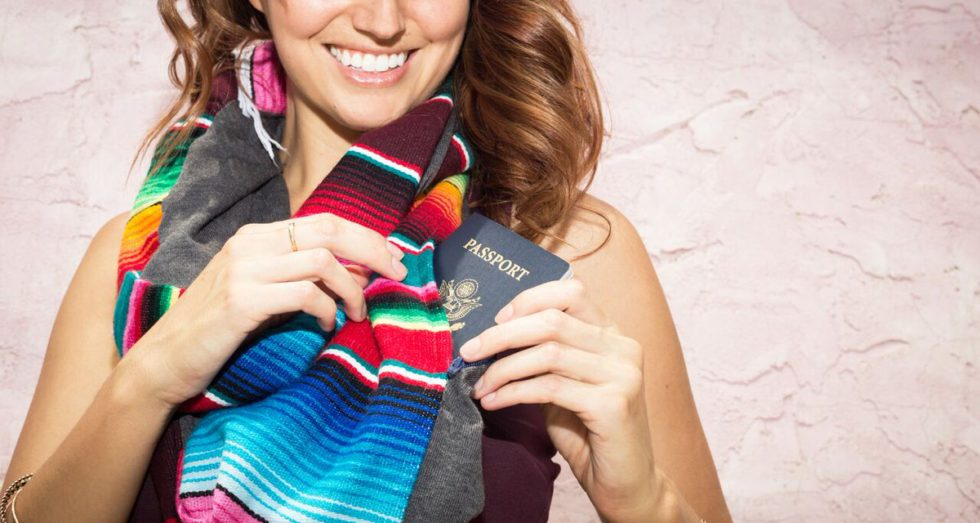 A girl wearing a colorful infinity scarf with a hidden zippered pocket.