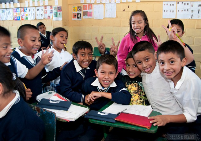 School children in Guatemala pose in their classroom.