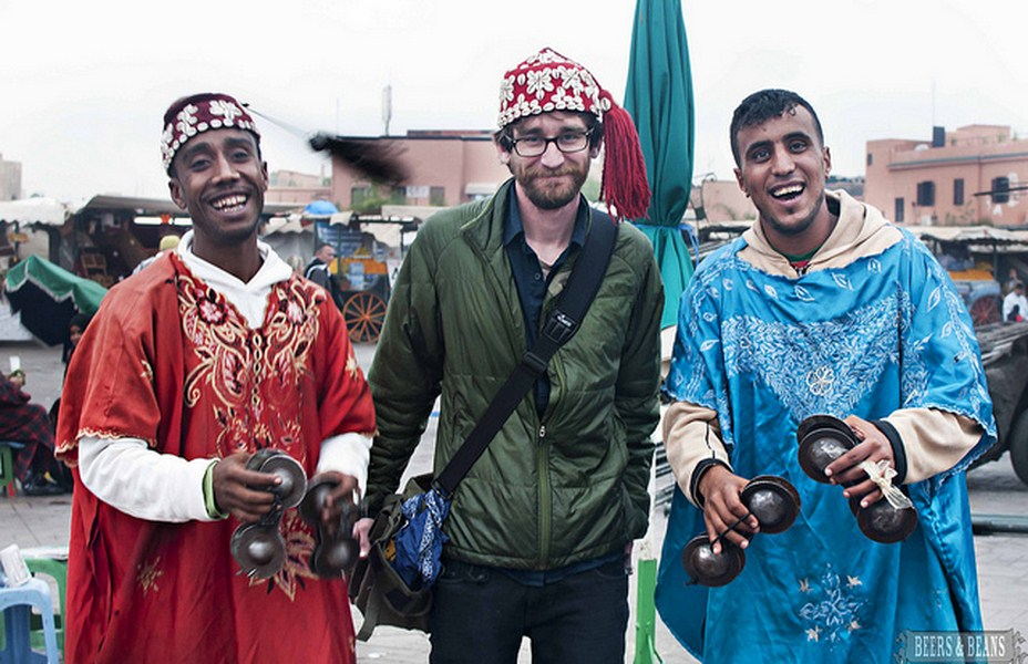 A man with locals in Marrakech, Morocco.