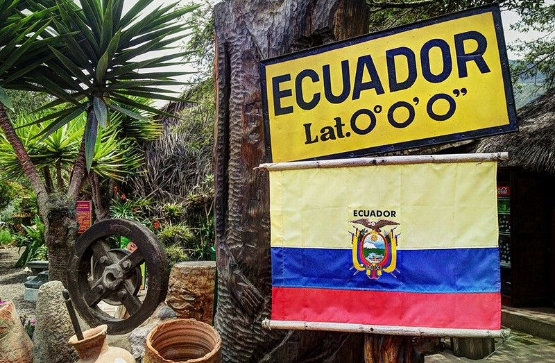 The official equator sign and Ecuadorian flag flying during our equator tour.