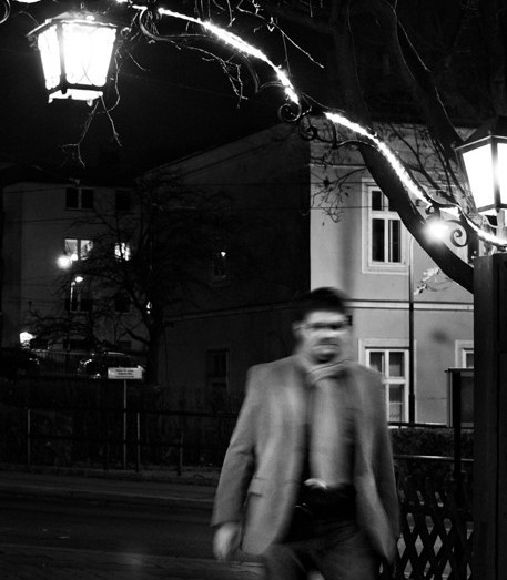 Man walking near a wine bar in Vienna.