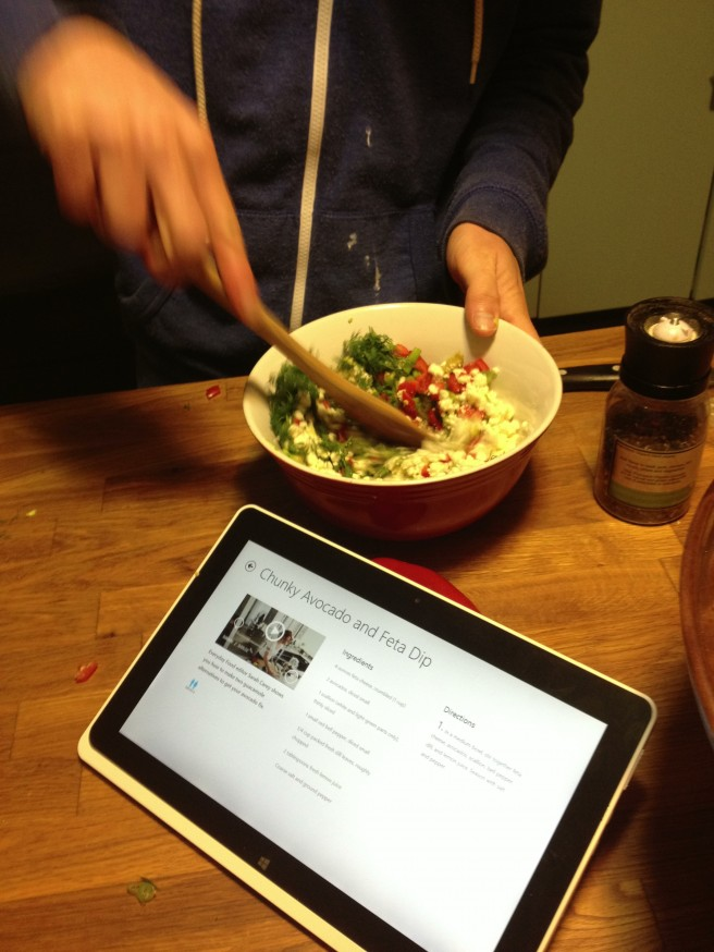 Stirring up the Chunky Avocado and Feta dip with the help of Acer W510 Iconia Tablet.
