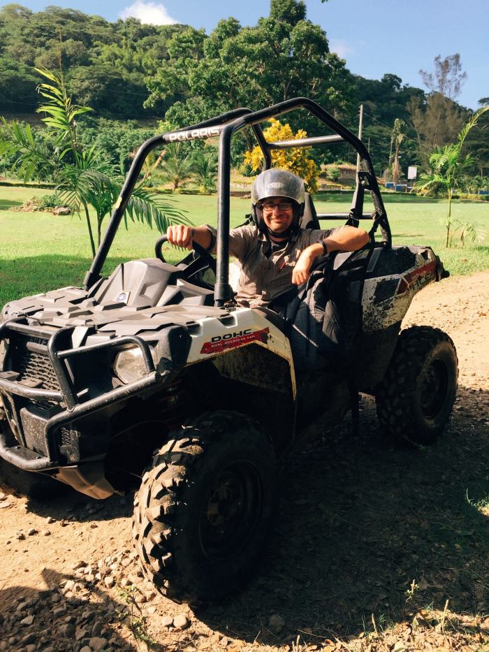 A man sitting on an ATV in Jamaica.