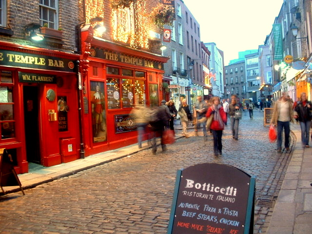 People rushing by the Temple Bar in Dublin, Ireland.